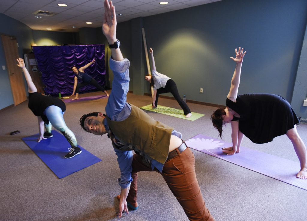Proctors employees take a 30 minute break to do yoga in the office. The weekly class started a month and a half ago, and managers have been supportive of their staff taking the time to stretch, breathe and reset before returning to work.