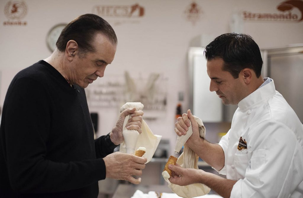 A Bronx Tale creator Chazz Palminteri pipes a cannoli at Villa Italia with owner Bobby Mallozzi Monday, September 24, 2018.
