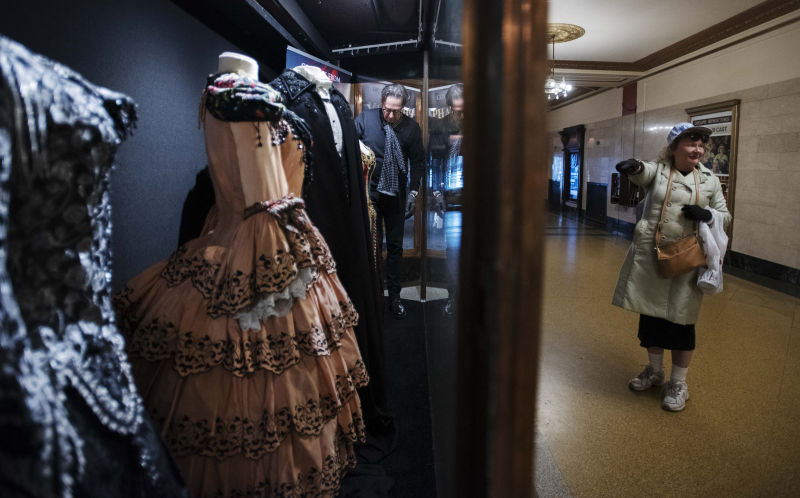 Creative director RIchard Lovrich and audience devcelopment and retention specialist Heather West assemble a window display showing past costumes from The Phantom of the Opera at Proctors Tuesday, April 23, 2019.