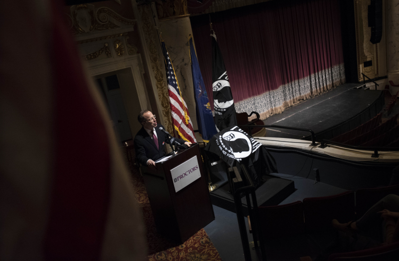 Albany Symphony Orchestra music director David Alan Miller speaks during the dedication of a POW/MIA Chair of Honor in Schenectady Tuesday, November 6, 2018. The chair, placed in the balcony of the theatre, will remain empty to honor American service members and recognize their sacrifice. The Albany Symphony Orchestra's performance of Britten's War Requiem will be the first performance where the POW/MIA Chair of Honor will be on display.