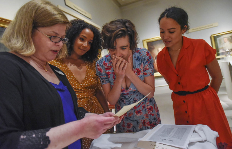 Actors from left Stephanie Umoh, Hannah Cruz, Olivia Puckett react to seeing a letter written to Elizabeth Schuyler from Alexander Hamilton during a private tour from curator Diane Shewchuck, far left, at the Albany Institute of History and Art in Albany Friday, August 16, 2019. Olivia Puckett plays Peggy Schuyler, Hannah Cruz plays Eliza Schuyler and Stephanie Umoh plays Angelica Schuyler in the touring production of Hamilton playing Proctors through August 25, 2019.