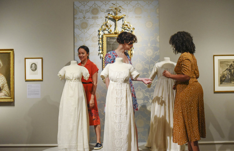 From left Olivia Puckett, Hannah Cruz and Stephanie Umoh look at period dresses in a display on the Schuyler sisters at the Albany Institute of History and Art in Albany Friday, August 16, 2019. Olivia Puckett plays Peggy Schuyler, Hannah Cruz plays Eliza Schuyler and Stephanie Umoh plays Angelica Schuyler in the touring production of Hamilton playing Proctors through August 25, 2019.