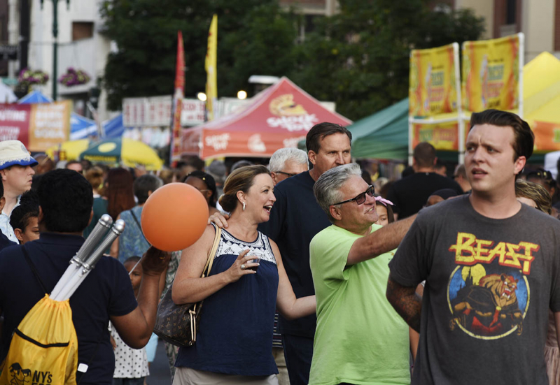 People flood the street in front of Proctors during the 13th Annual Schenectady County Summer Night Friday, July 13, 2018.