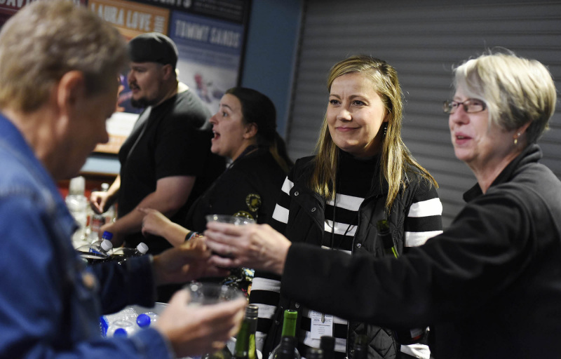 Proctors employees Christine Sheehan, center, and Judie Bouchard serve volunteers drinks during Volunteer Appreciation Night in Robb Alley at Proctors Wednesday, September 18, 2019. Photo credit Kate Penn - Proctors